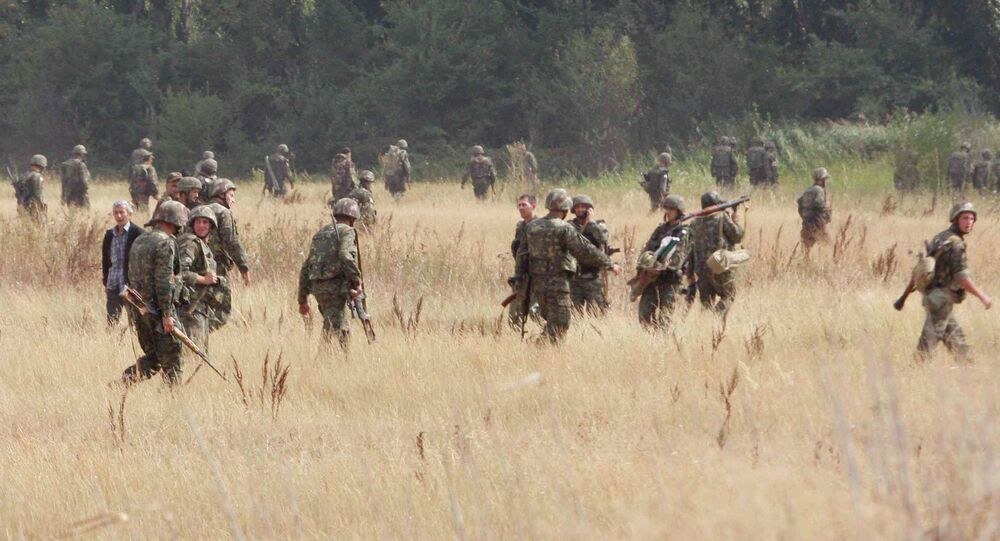 Georgian soldiers walk in the outskirts of the northern Georgian town of Gori, on Saturday, Aug. 9, 2008