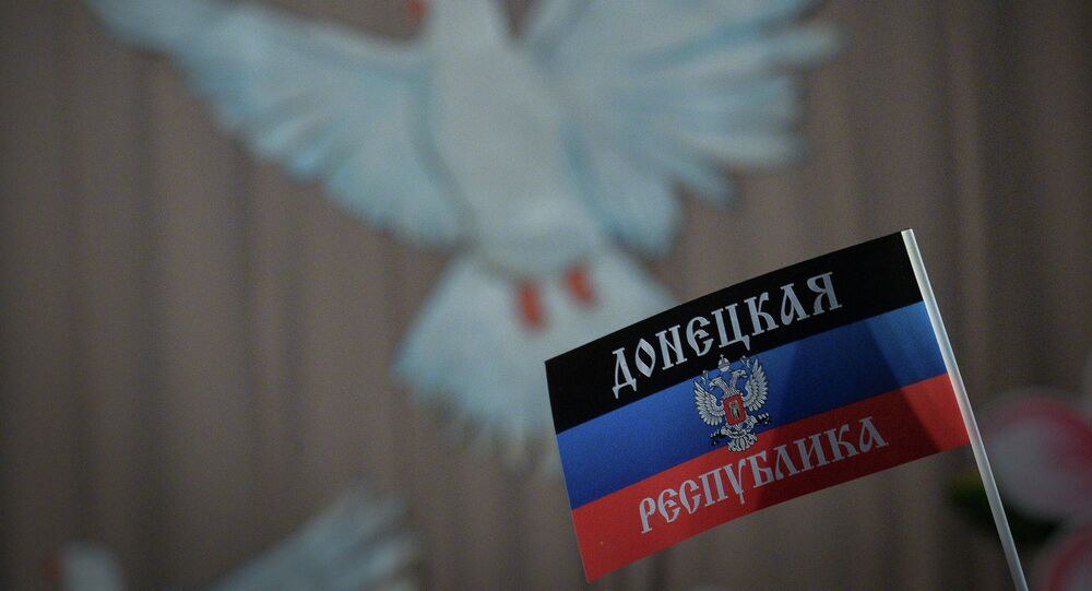 A flag with the symbols of the Donetsk People's Republic.