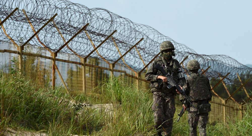 South Korean soldiers patrol along the scene of a blast inside the demilitarized zone separating the two Koreas in Paju, South Korea, in this picture taken on August 9, 2015