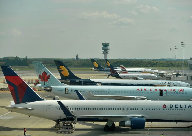 The Belgocontrol tower is seen in the background, and aeroplanes grounded on the runway of Brussels airport in Zaventem, as the whole Belgian aerial space is closed after a power cut at air traffic control organization Belgocontrol, on May 27, 2015