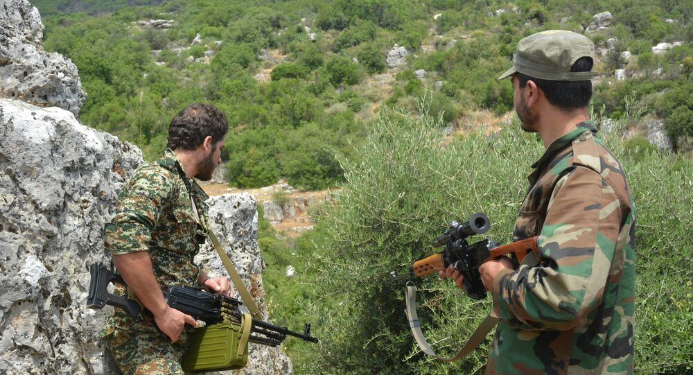 Syrian pro-government forces patrol an area in the Sahl al-Ghab, in Hama province.