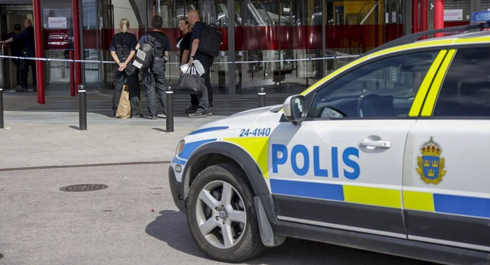 Police officers are seen in front of an Ikea store in Vasteras, central Sweden