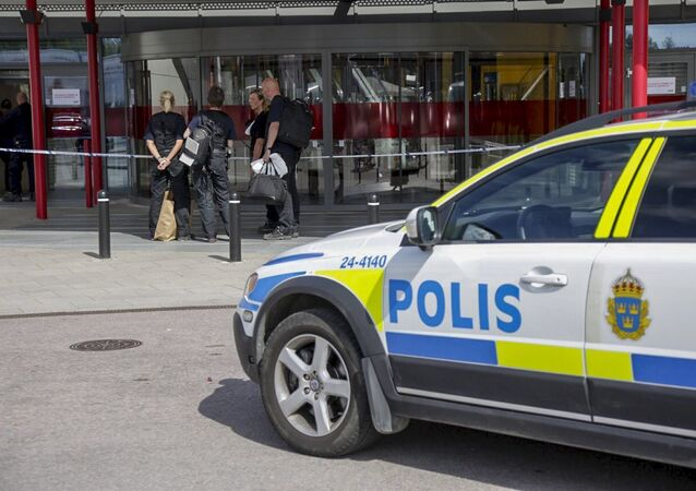Police officers are seen in front of an Ikea store in Vasteras, central Sweden, August 10, 2015