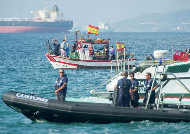 Vessels of the Guardia Civil and Gibraltar police prevent Spanish fishermen from entering waters around the Rock of Gibraltar during protest in the bay of Algeciras on August 18, 2013