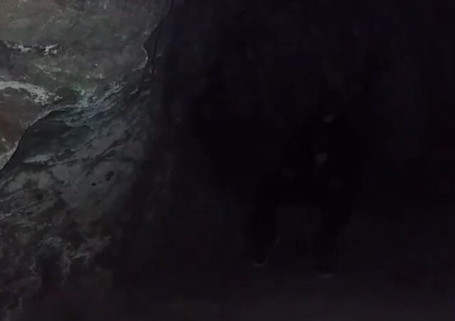 Testing out the accoustics of a singing cave