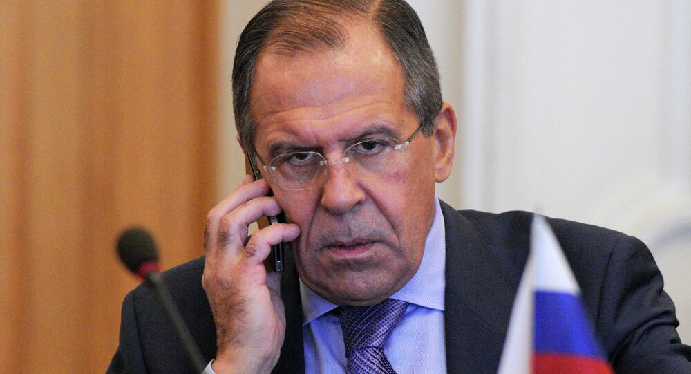 Russian Foreign Minister Sergey Lavrov speaks on the phone