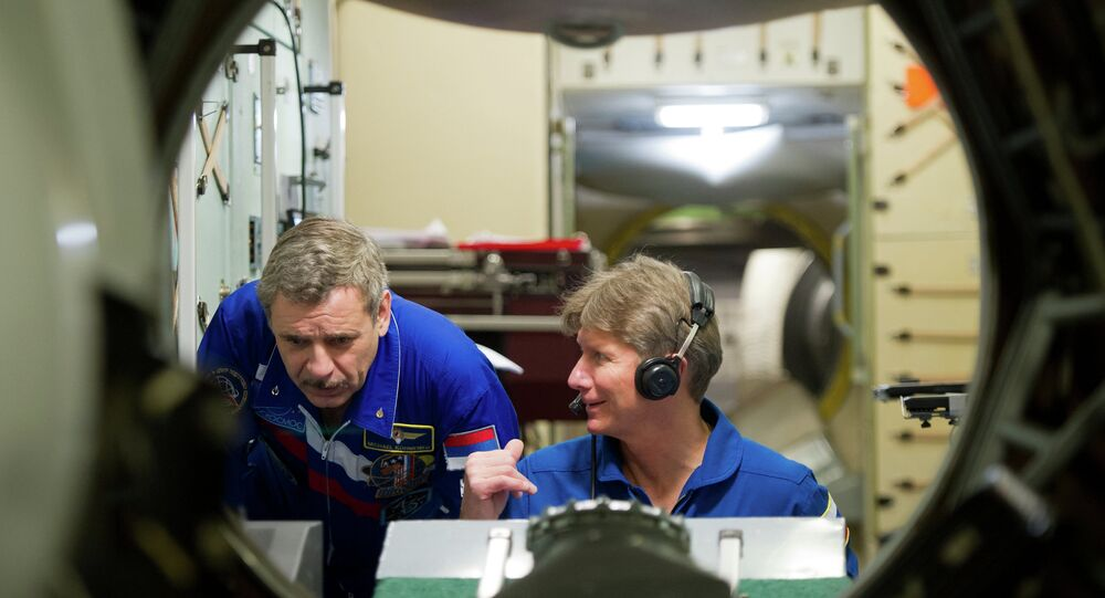 Russian Cosmonauts Mikhail Korniyenko (left) and Gennady Padalka, members of the International Space Station 43/44 crew, seen during their work-outs on the ISS simulator at the Star City