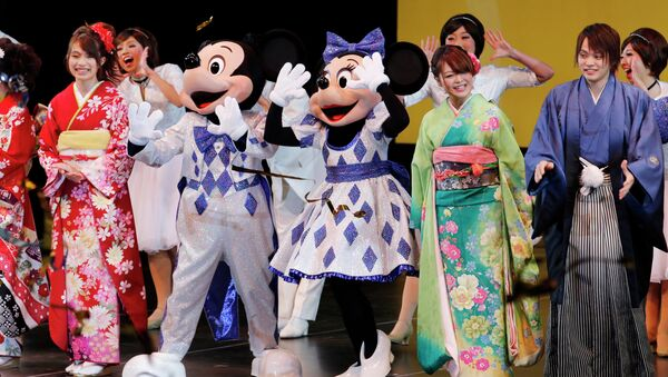 People celebrate with Disney characters on stage during a ceremony at Tokyo Disneyland. - Sputnik International