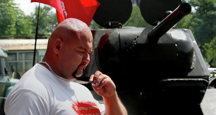 Muscleman Ivan Savkin pulls T-34 tank