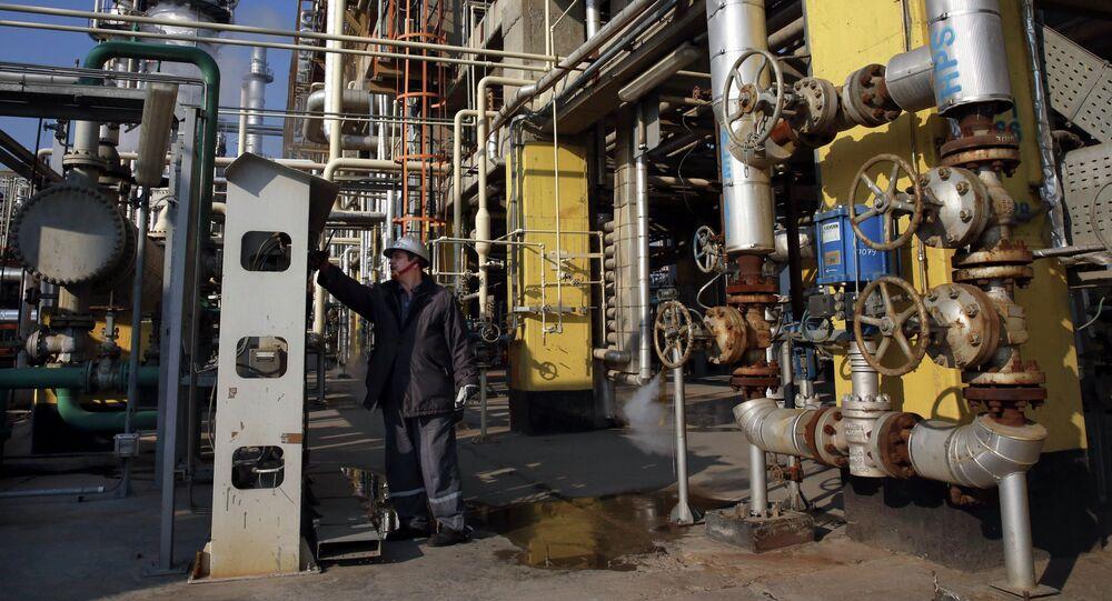 Tehran's oil refinery supervisor Jafar Jaleh Rafati, works at a unit of the refinery, south of the capital Tehran, Iran, Monday, Dec. 22, 2014