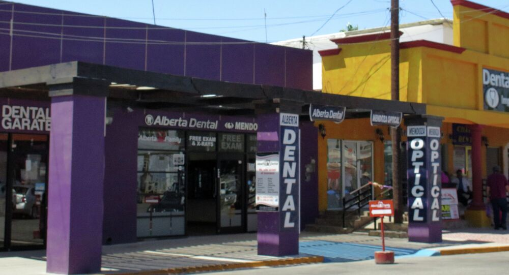 In this Thursday, April 30, 2015 photo, a street full of a dental offices is seen in Los Algodones, Mexico, which sits on the border with California