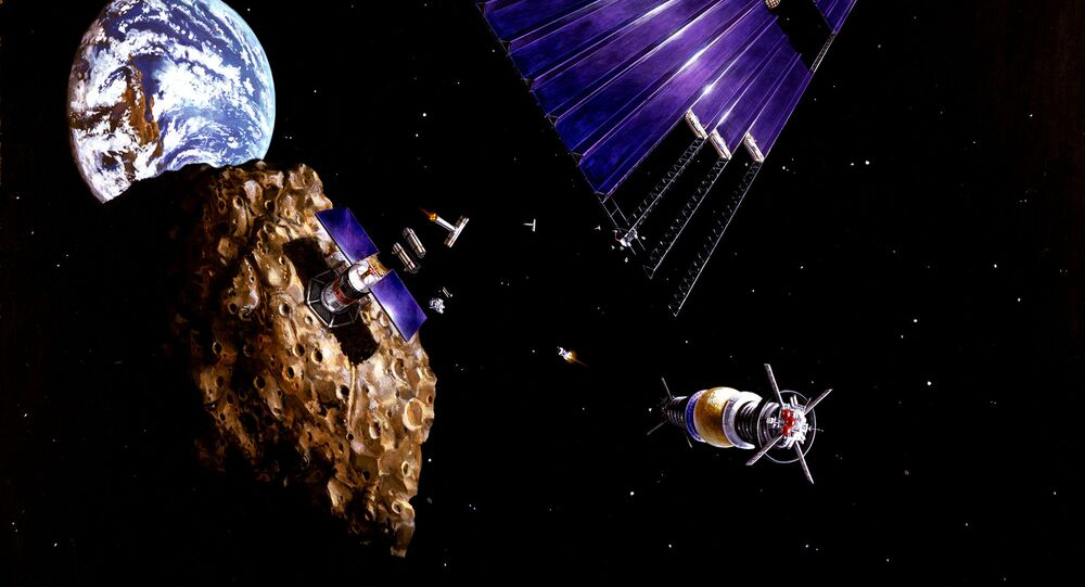 This painting shows an asteroid mining mission to an Earth-approaching asteroid
