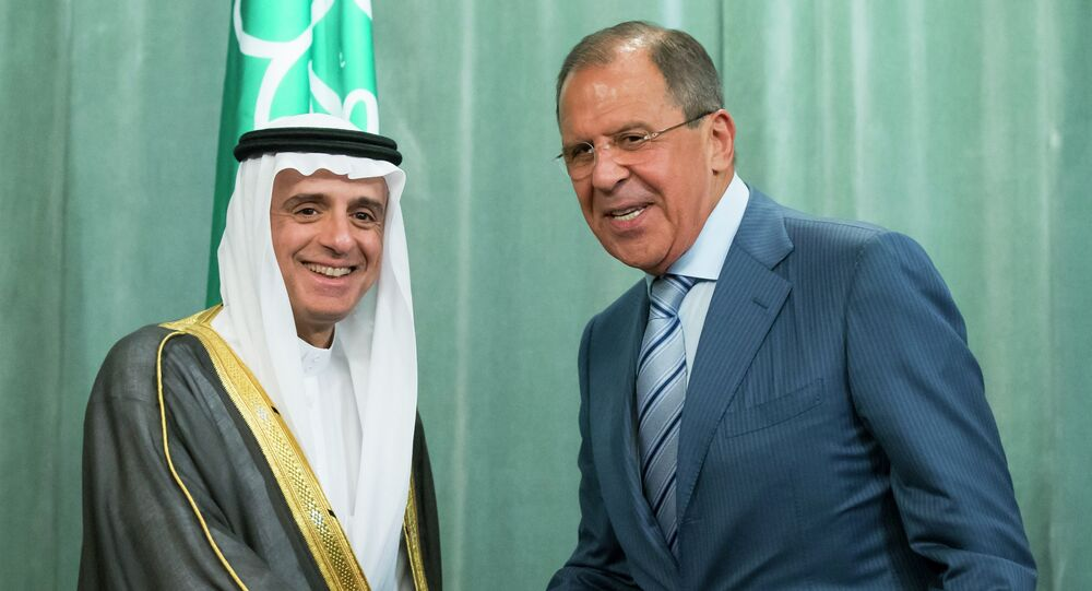 Russian Foreign Minister, Sergey Lavrov, right, and Saudi Arabia Foreign Minister, Adel bin Ahmed Al-Jubeir, shake hands after a news conference following their meeting in Moscow, Russia, Tuesday, Aug. 11, 2015
