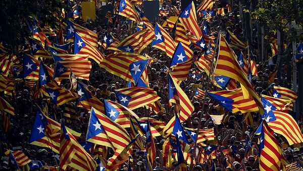 A file picture taken on September 11, 2014 shows demonstrators waving Estelada flags (Catalan independentist flags) during celebrations of the Diada (Catalonia National Day) in Barcelona. - Sputnik International