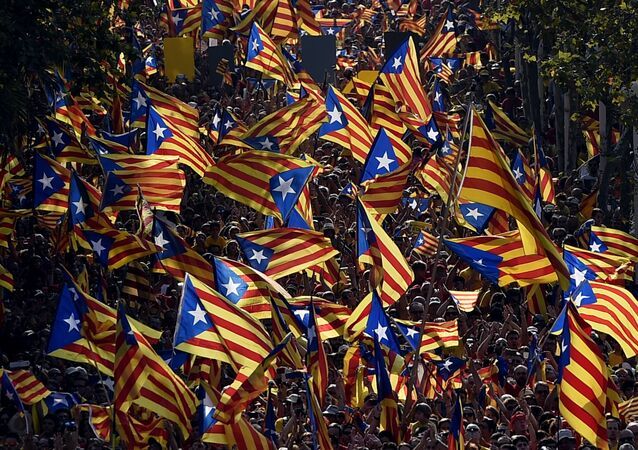 A file picture taken on September 11, 2014 shows demonstrators waving Estelada flags (Catalan independentist flags) during celebrations of the Diada (Catalonia National Day) in Barcelona.