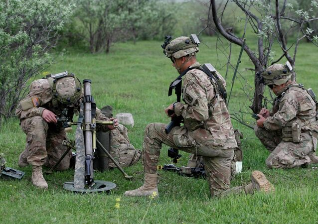 US soldier aims a mortar during the joint US-Georgia military exercise Noble Partner 2015 at the military base of Vaziani outside Tbilisi, Georgia, Sunday, May 17, 2015