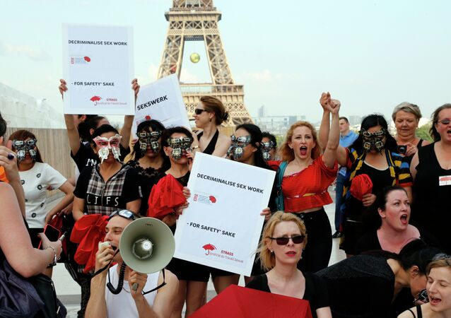 Sex workers take part in a demonstration called by the Strass union and the Roses d'Acier association on June 5, 2015 on the Trocadero square in Paris