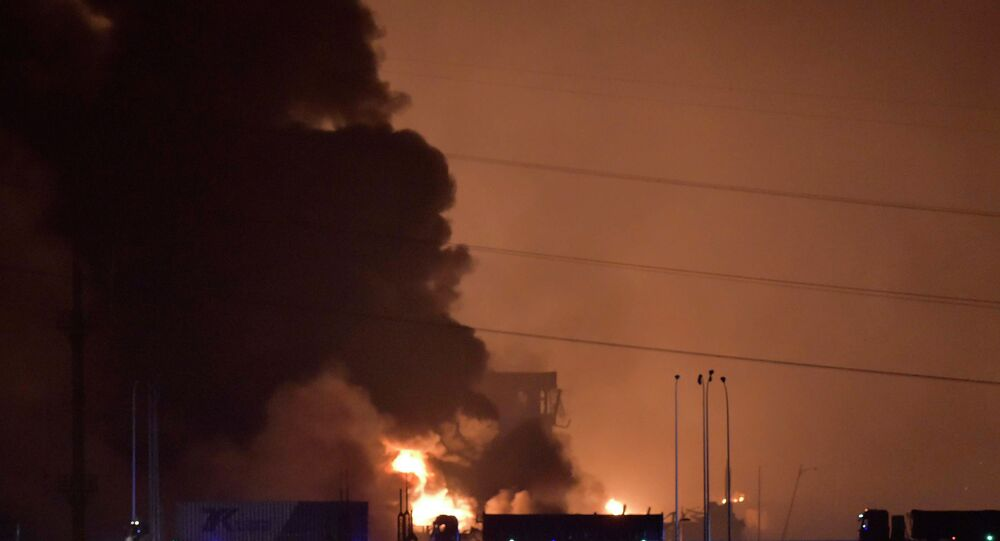 Smoke and fire rises after an explosion in the Binhai New Area in north China's Tianjin Municipality on Thursday Aug. 13, 2015.