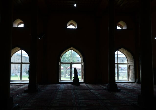 A Kashmiri Muslim woman walks after praying inside the grand mosque Jamia Masjid during Ramadan in downtown Srinagar on June 25, 2015. File photo