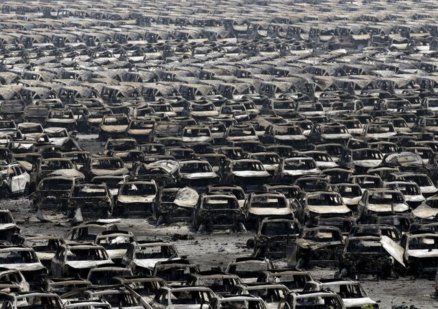 Damaged cars are seen near the site of the explosions at the Binhai new district, Tianjin, August 13, 2015