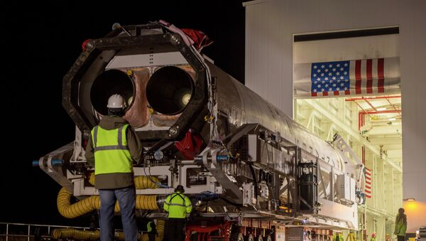 An Orbital Science Corporation Antares rocket is seen as it is rolled out to launch Pad-0A at NASA's Wallops Flight Facility Tuesday, December 17, 2013 in advance of a Thursday launch, Wallops Island, VA. - Sputnik International