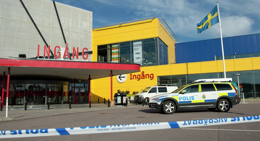 Police cars are parked outside IKEA store in the city of Vaesteraas, about 100 km west of Stockholm on August 10, 2015
