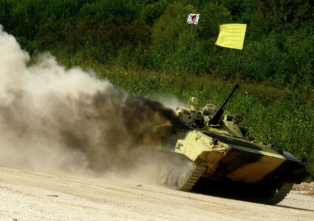The Russian Army's crew takes part in the Suvorov Onslaught competition of infantry combat vehicles at the International Army Games 2015, Alabino base outside Moscow