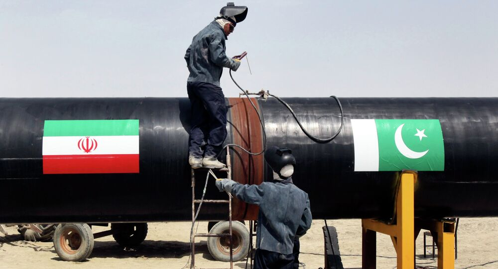 FILE - In this March 11, 2013 file photo, Iranian workers weld two gas pipes together at the start of construction on a pipeline to transfer natural gas from Iran to Pakistan, in Chabahar, southeastern Iran, near the Pakistani border