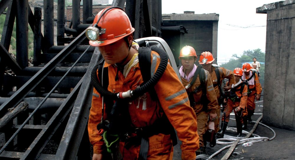 Rescuers head to examine the fire conditions coal mine
