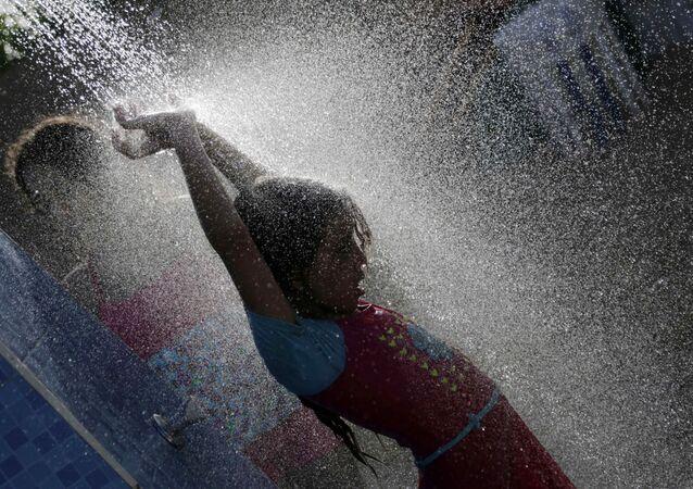 Girl taking a shower.