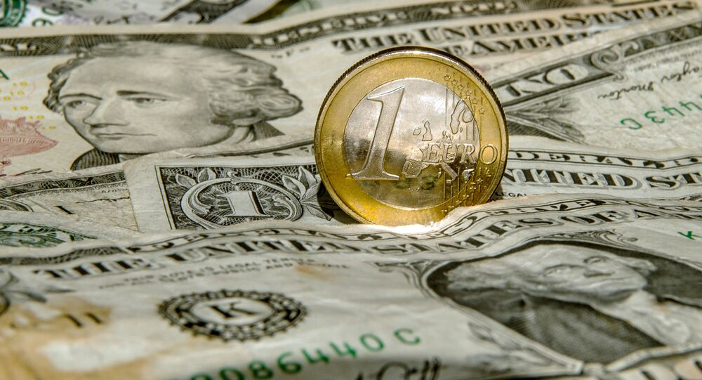 A one euro coin is pictured on one US dollar notes
