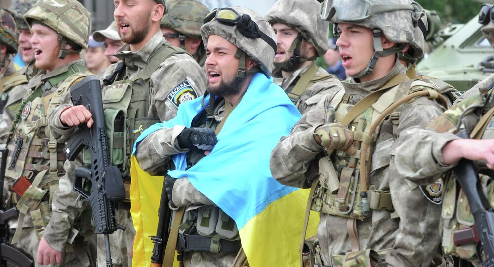 Servicemen of Eastern Corps, a special company of the Ukrainian Ministry of Internal Affairs, take the oath during a farewell ceremony in northeastern Ukrainian city of Kharkiv