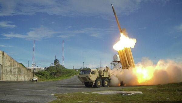 A Terminal High Altitude Area Defense (THAAD) interceptor is launched during a successful intercept test, in this undated handout photo provided by the U.S. Department of Defense, Missile Defense Agency - Sputnik International