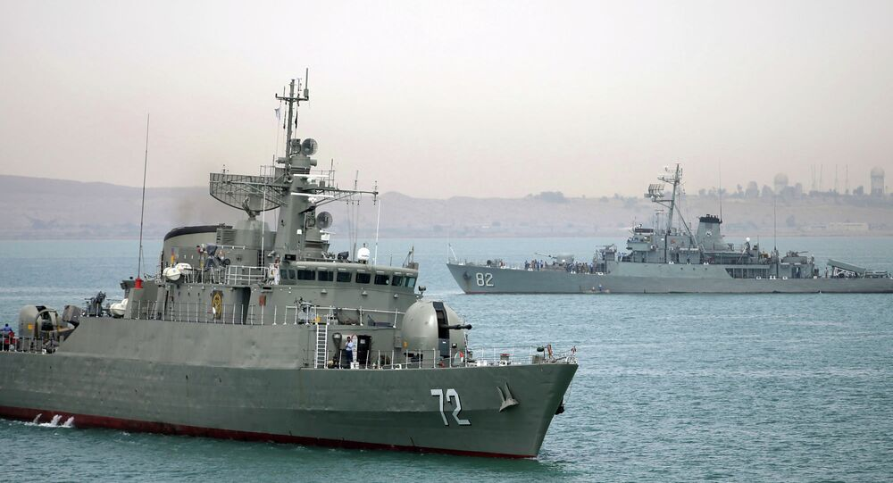 Iranian warship Alborz, foreground, prepares before leaving Iran's waters.