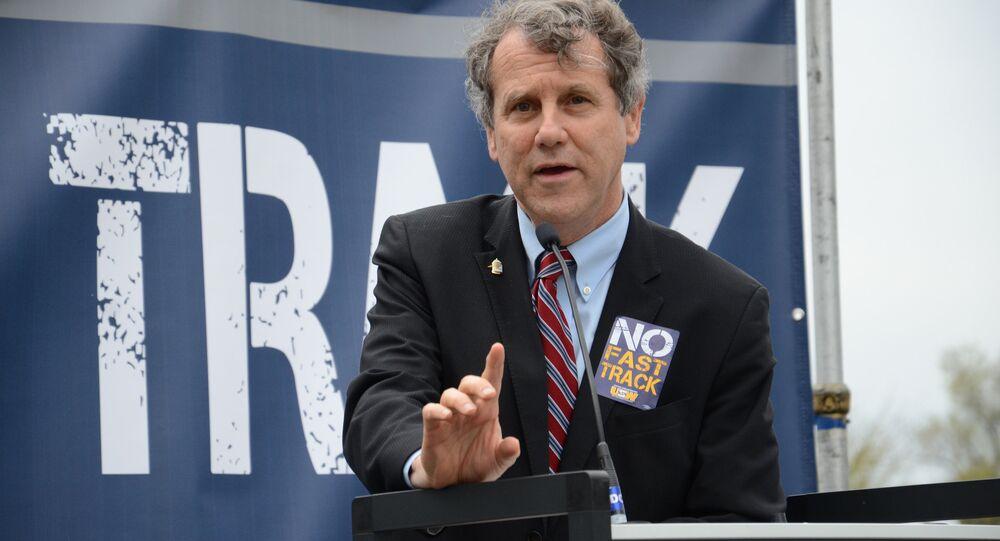 Senator Sherrod Brown participates in a #StopFastTrack rallies in Washington in April