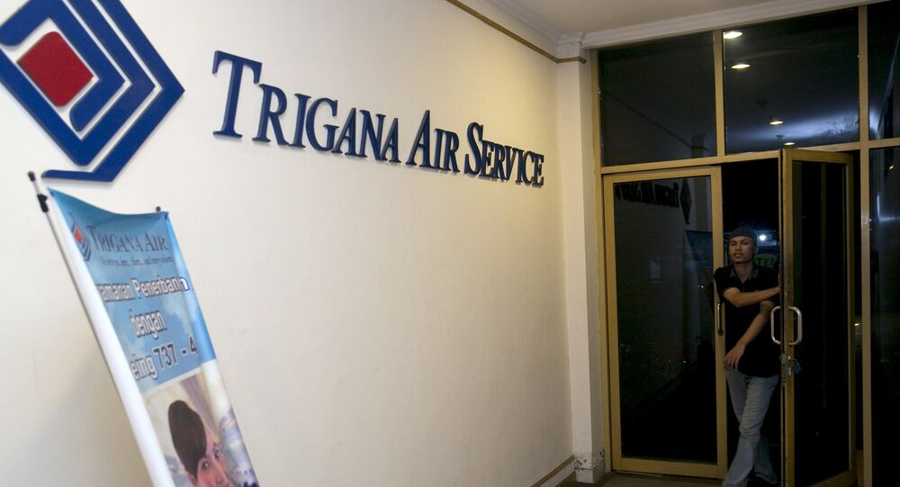 A man walks into the entrance of Trigana Air's office in Jakarta, Indonesia August 16, 2015