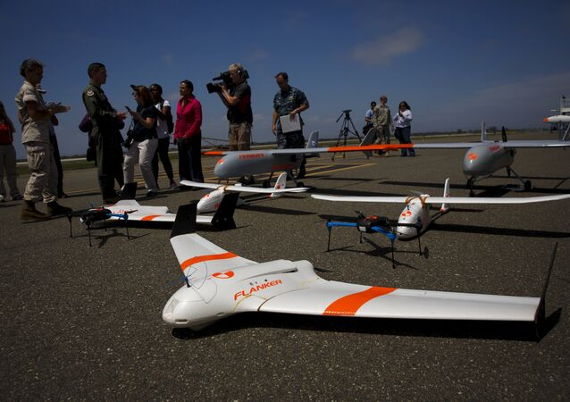 FireFlight UAS unmanned aerial vehicles TwinHawk, Scout, Flanker, and Hawkeye 400, are displayed on the tarmac during Black Dart, a live-fly, live fire demonstration of 55 unmanned aerial vehicles, or drones, at Naval Base Ventura County Sea Range, Point Mugu, near Oxnard, California July 31, 2015