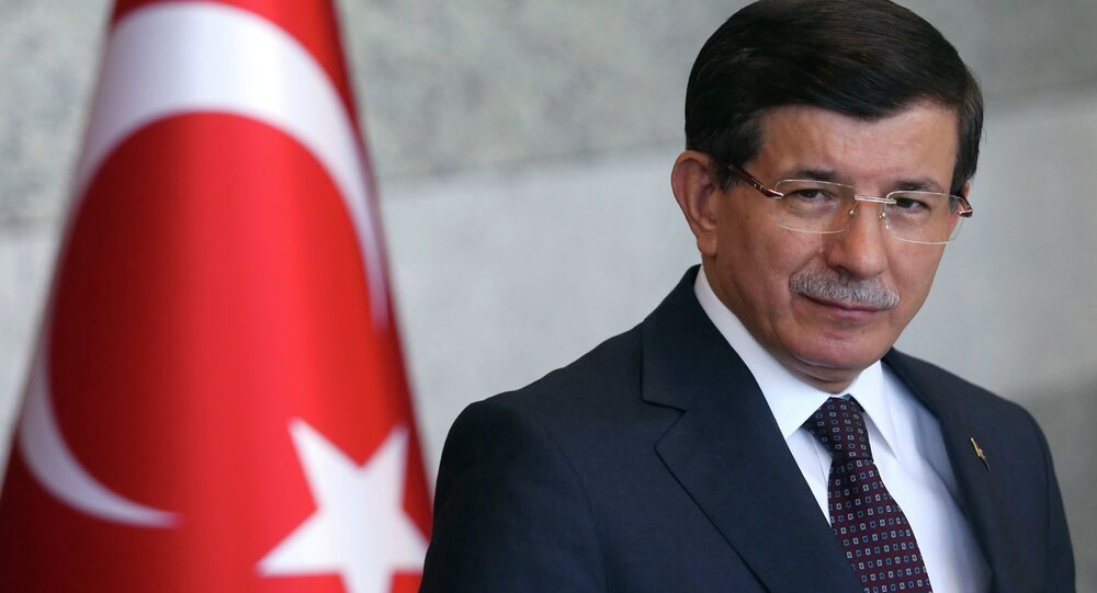 Turkish Prime Minister Ahmet Davutoglu pauses as he speaks to the media in Ankara, Turkey