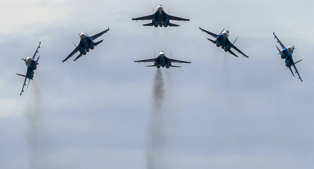 The performance of the Strizhi aerobatic team in MiG-29 jets during a show at the ARMY 2015 International Military-Technical Forum held outside Moscow
