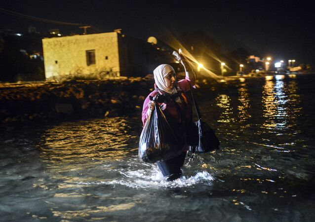 A migrant walks to a boat to reach the Greek island of Kos on early August 18, 2015.
