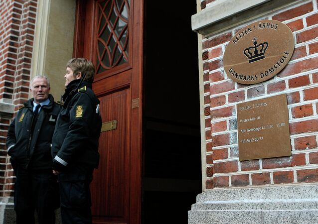 Two police officers stand outside the courthouse in Aarhus, Denmark