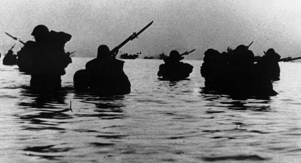 Silhouetted against the twilight, invading Japanese soldiers are seen as they wade ashore south of Shanghai, on May 13, 1941