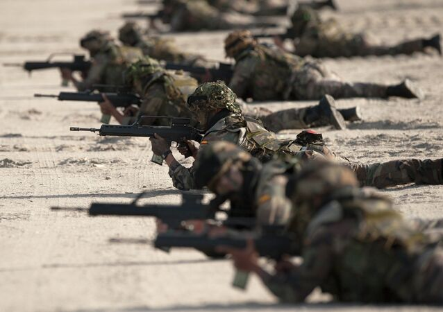 Spanish Navy Marines take positions during a military exercise in the Garrucha beach near Almeria, Spain