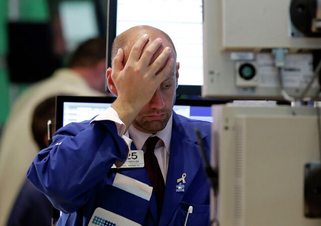 Specialist Meric Greenbaum works at his post on the floor of the New York Stock Exchange, Wednesday, Aug. 12, 2015