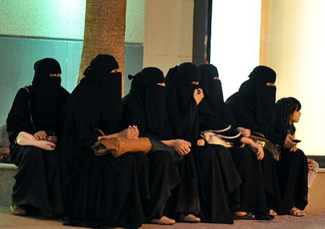 Saudi women wait for their drivers outside a shopping mall in Riyadh on September 26, 2011 a day after King Abdullah granted women the right to vote and run in municipal elections.
