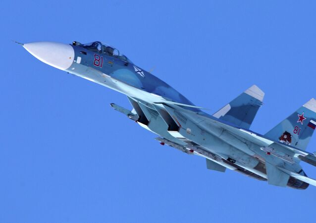 Carrier-based Sukhoi Su-33 jet fighter of the 279th Shipborne Fighter Aviation Regiment of the Northern Fleet on a training mission over Severomorsk-3 aerodrome
