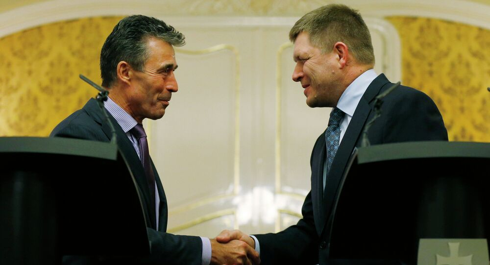 NATO Secretary General Anders Fogh Rasmussen, left, shake hands with Slovakia's Prime Minister Robert Fico as they meet in Bratislava, Slovakia, Thursday, May 15, 2014