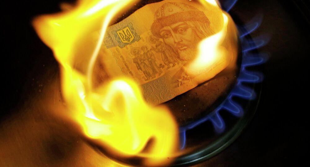 A burning one hryvnia bill on a gas burner
