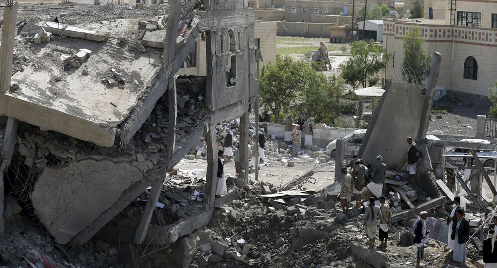 Houthi militants gather on the rubble of the offices of the education ministry's workers union, destroyed by Saudi-led air strikes, in Yemen's northwestern city of Amran August 19, 2015
