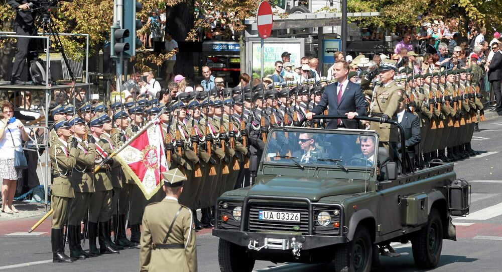 Polish President Andrzej Duda and Chief of Staff Gen. Mieczyslaw Gocul review troops prior to a military parade during Armed Forces Day in Warsaw, Poland August 15, 2015